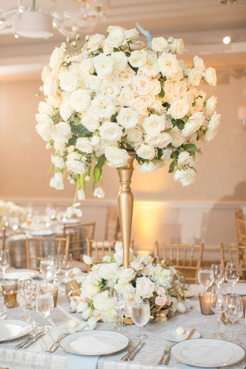 Luxe modern wedding with crystal rock agate details in dallas white rose tulip arrangement on gold stand photo thisbe grace photography izmirmasajfo
