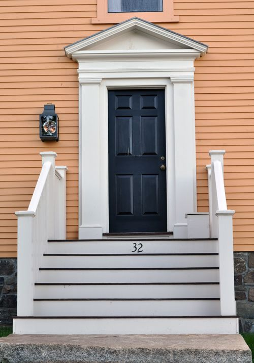 Colonial entrance with railing on steps. Era-appropriate wall ...