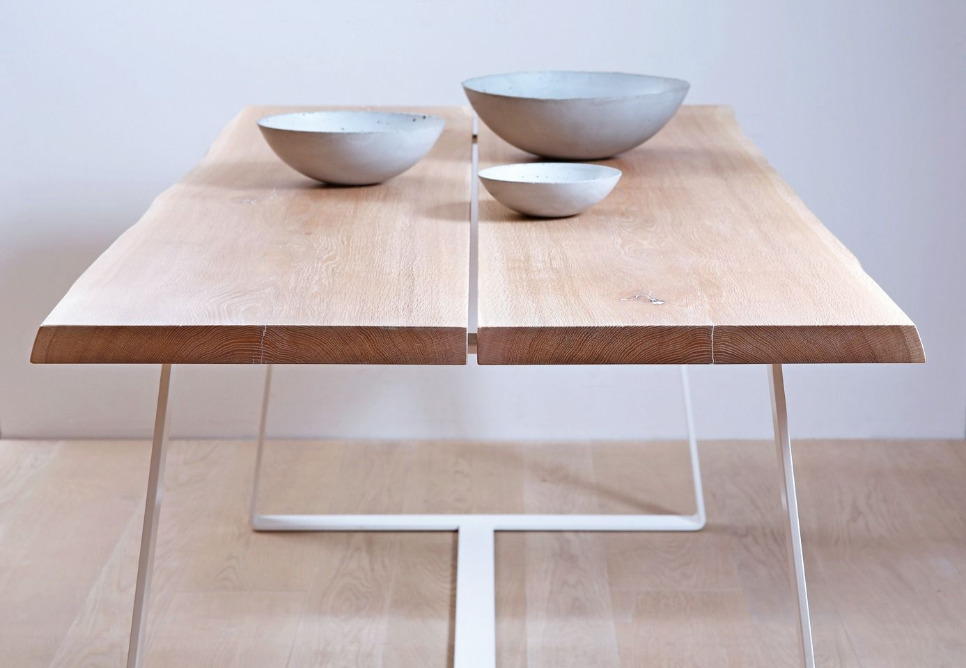 Solid oak table with white steel legs.