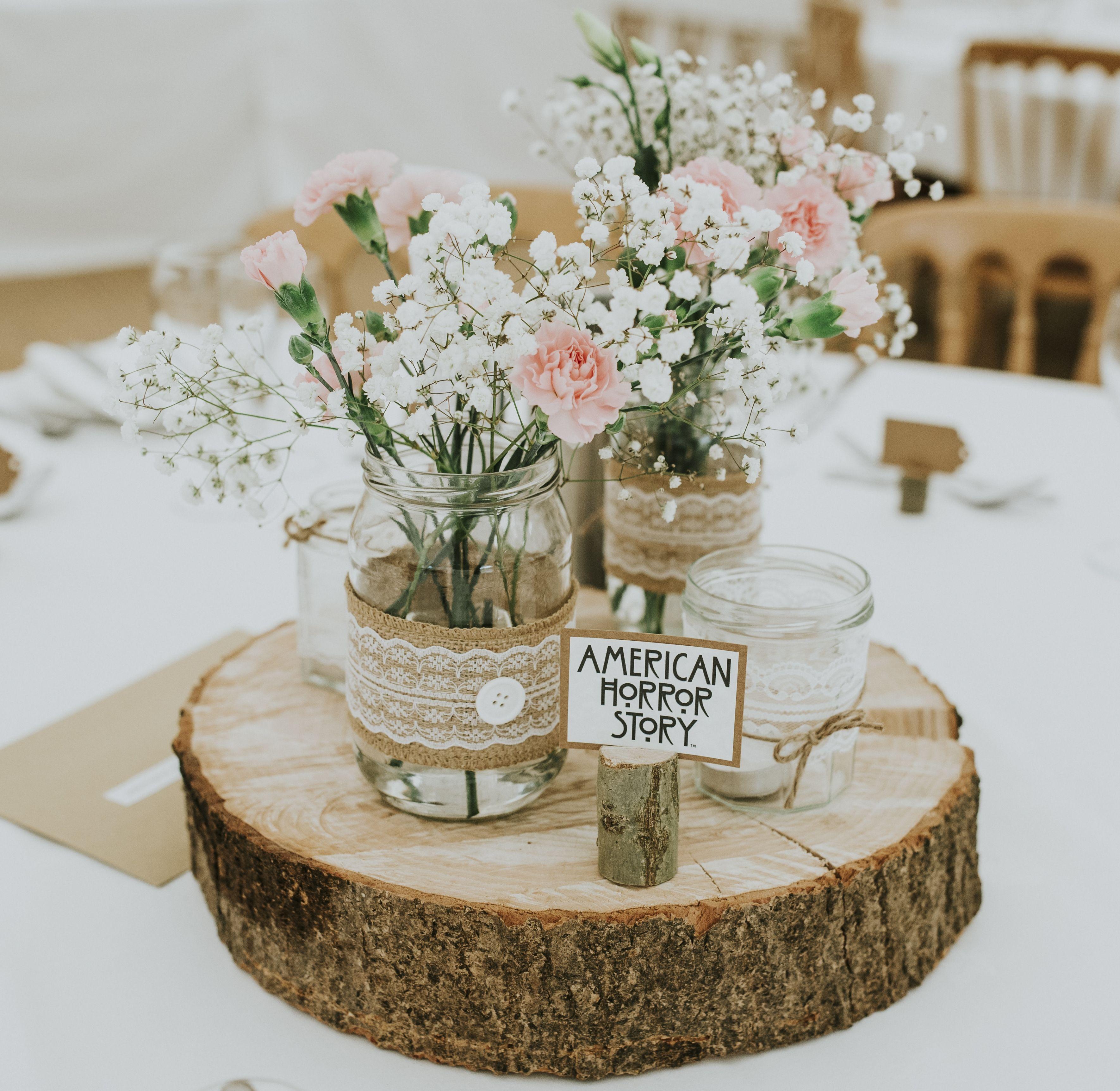 Wedding Centerpiece: Jam jars, hessian, lace on log slices ...