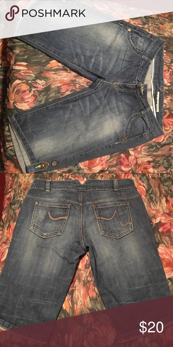 Long jean shorts Really cute denim long shorts . Has cute patten on pockets. Fits well. DKNY Shorts Jean Shorts