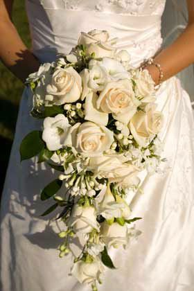 Dawnhorstedflowers.co.uk Soft shades of white and cream roses for a classic wedding bouquet