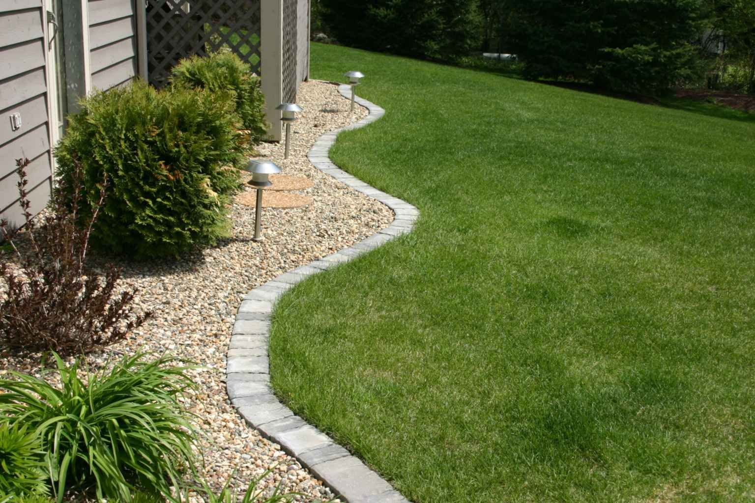 Lawn edging paver edging home pinterest gardens for Stone landscaping ideas