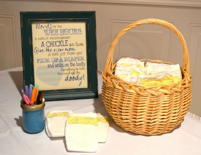 A Travel Theme Baby Shower - Write a special or funny note on a diaper for the mom & dad to-be!