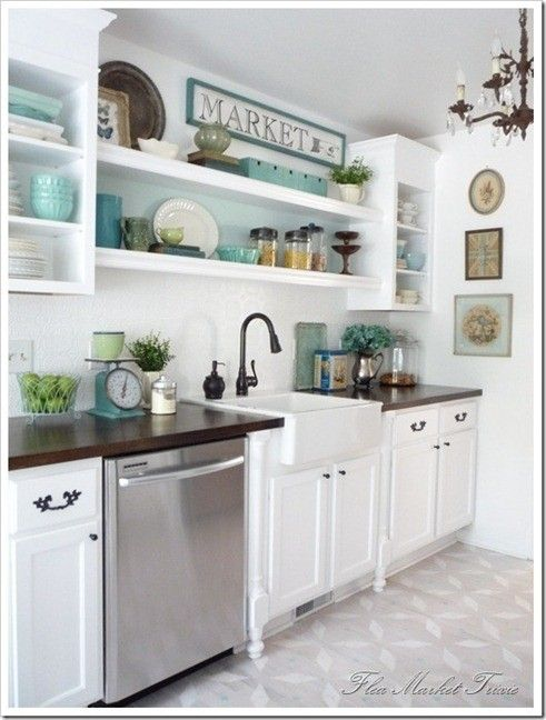 Open shelves a popular trend in kitchen designs these days are perfect for showing off collections and flea market style i like the light turquoise