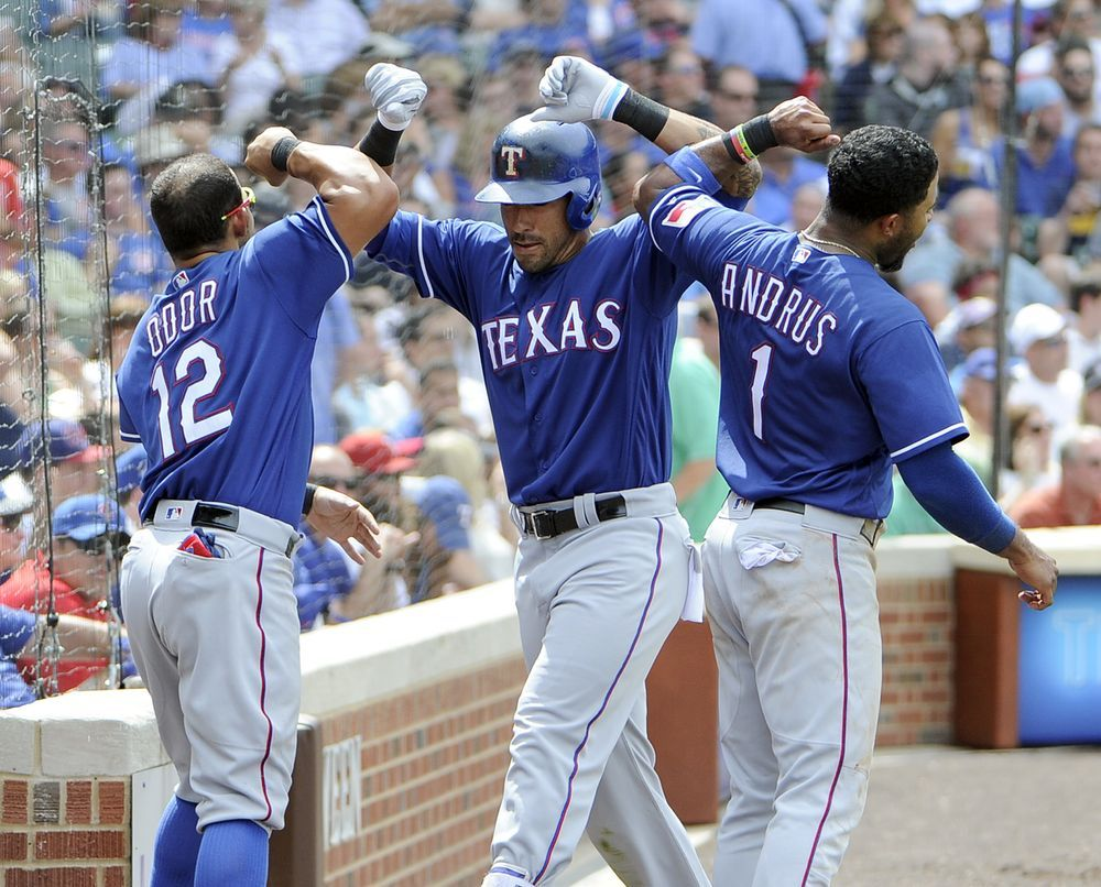 Texas Rangers Ian Desmond Center Is Greeted By His Teammates Elvis Andrus 1 And Rougned Odor 12 Af Texas Rangers Baseball Texas Rangers Rangers Baseball