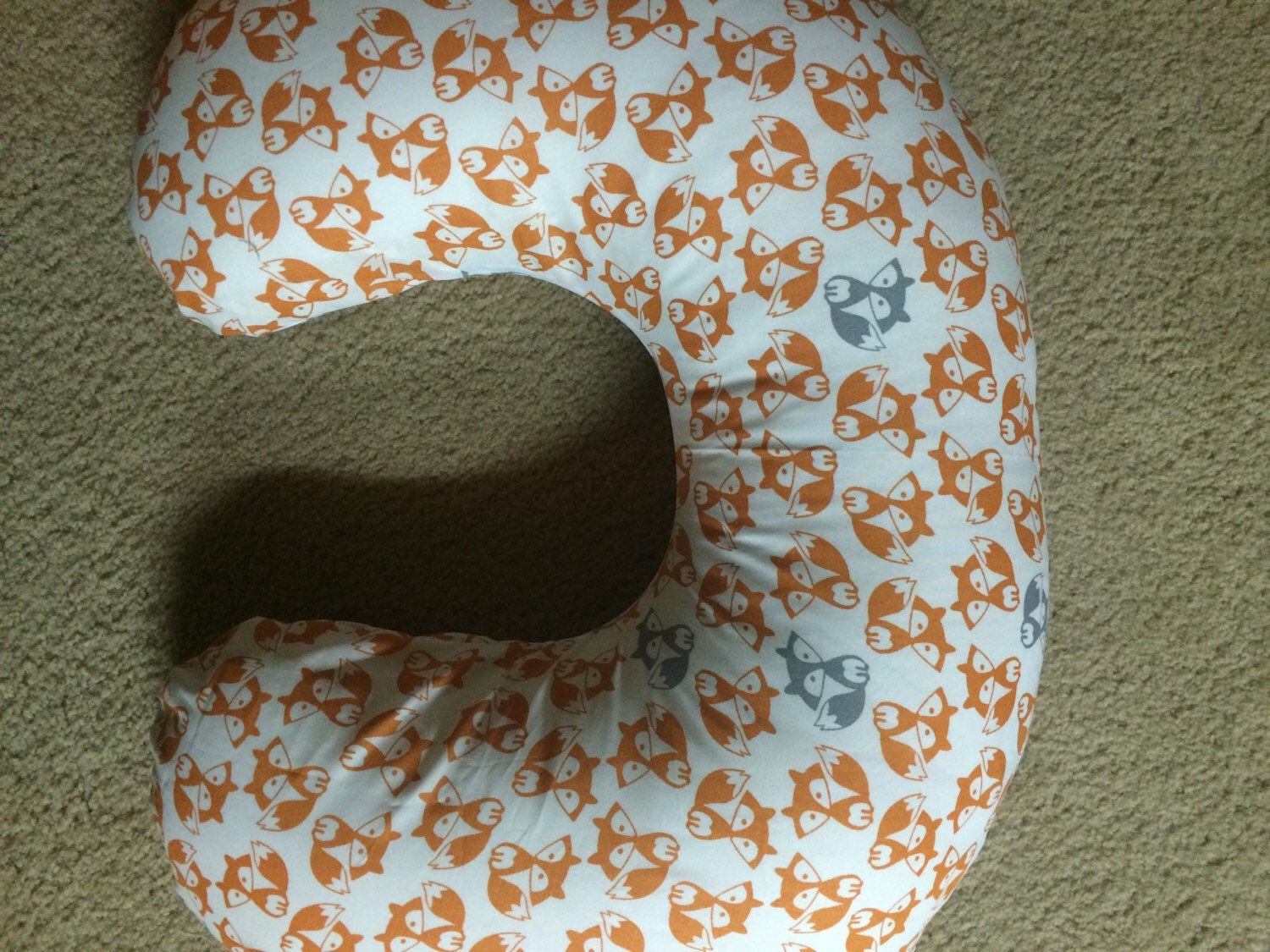 A personal favorite from my Etsy shop https://www.etsy.com/listing/230645879/gray-and-orange-fox-nursing-pillow-cover