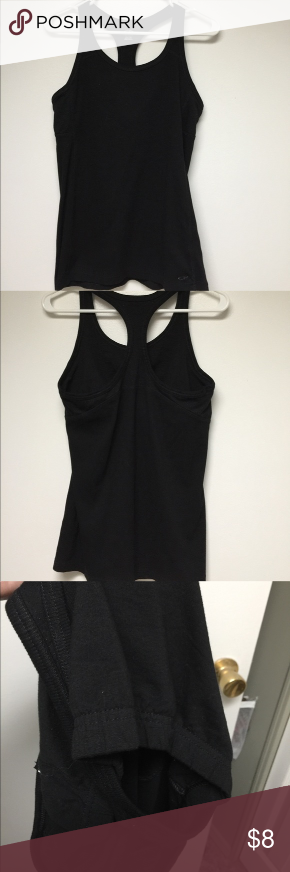Champion tank top Black tank top has built in shelf bra. Never worn or laundered. Size XL Champion Tops Tank Tops