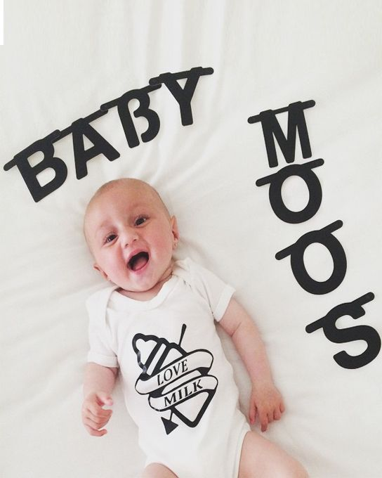 Tattoo baby grow with old style tattoo print, yo-ho-ho & a bottle of milk! Trendy baby grow in white with FREE UK P&P & FREE gift packaging! Get Milky!
