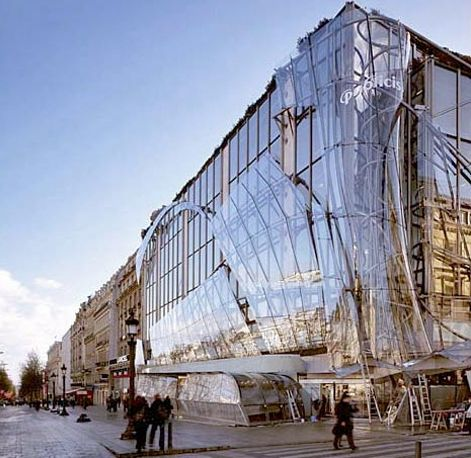 cf709d2c6b5fb7 Drugstore Publicis in Paris with facade dressed in glass. The building was  surrounded in a gigantic veil of curved glass reflecting the bustle of the  Avenue ...