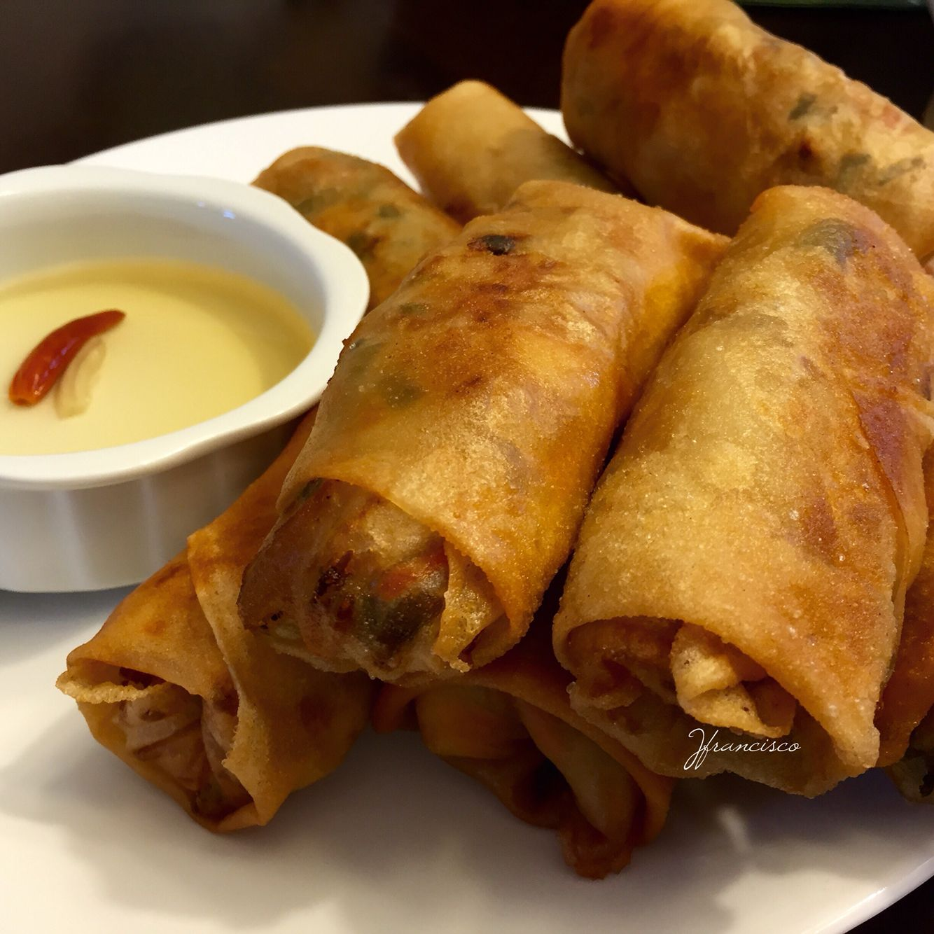 """Lumpiang prito (""""fried vegetable spring roll""""), consists of a briskly fried pancake filled with sautéed bean sprouts and various other vegetables such as green beans and carrots. Small morsels of meat, seafood or tofu may also be added. Lumpiang prito is dipped in a spicy vinegar with chilis."""