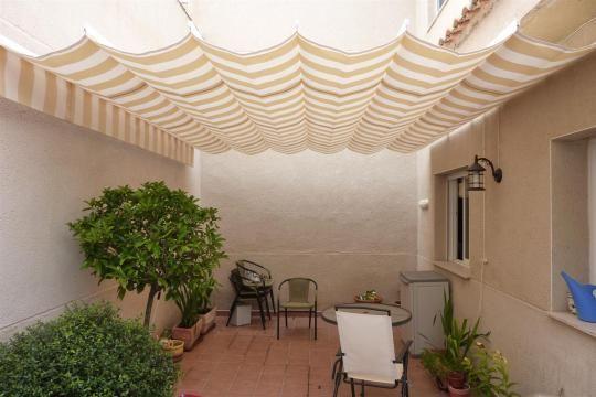 Resultado de imagen para formas de colocar mediasombra ambientes - sombras para patios