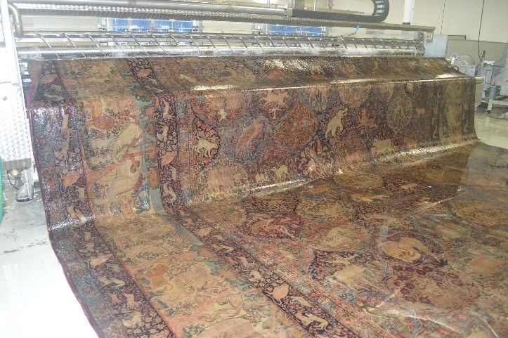 Antique Kerman rug during wash process. (posed for the photo-up to see the size!)