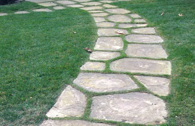 Commercial and residential flagstone experts for Stone path in grass