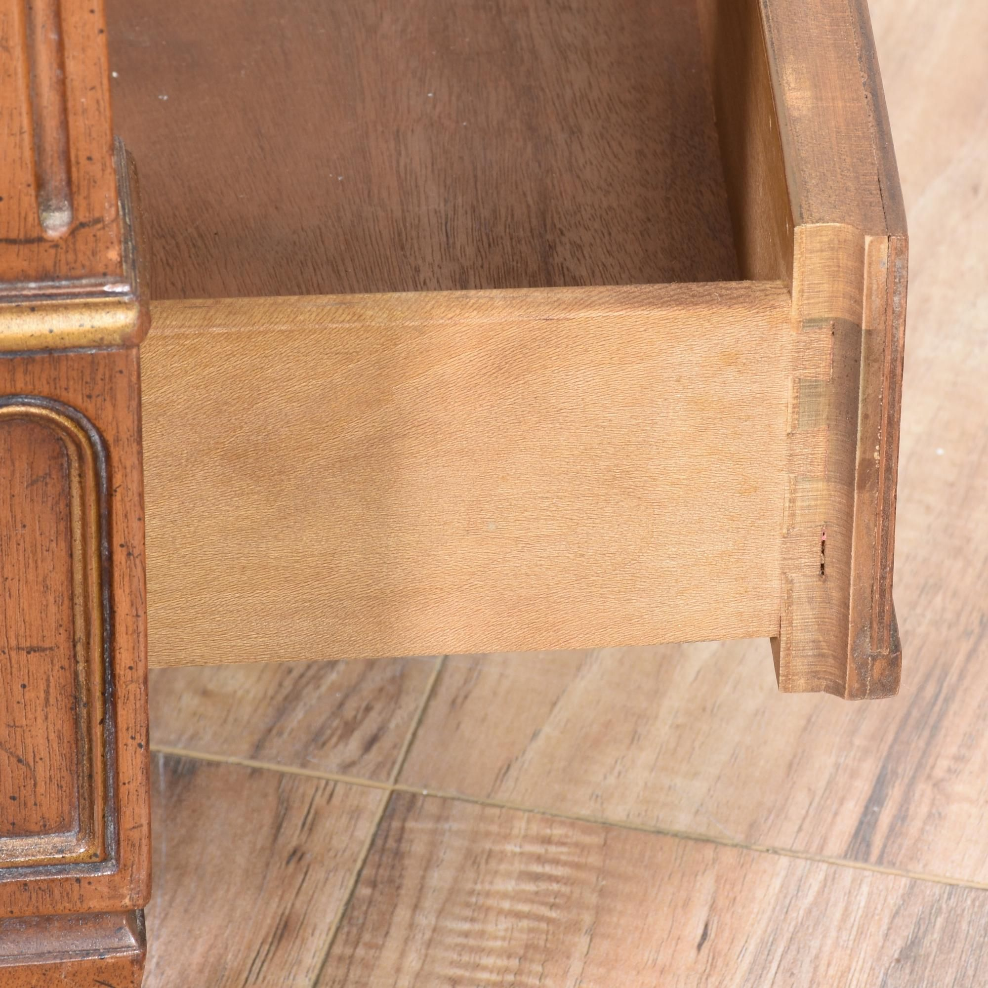 this henredon side table is featured in a solid wood with a burl