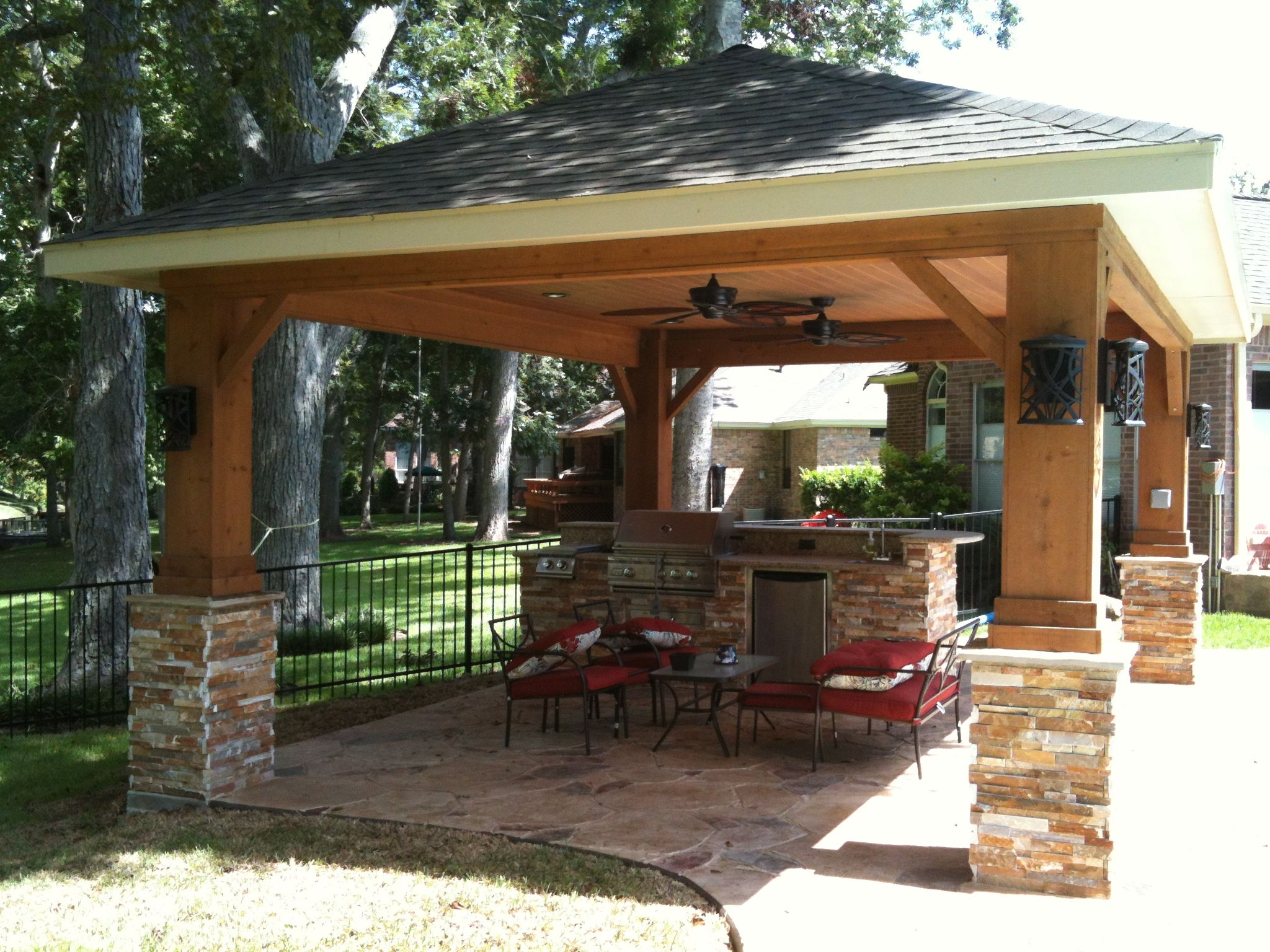 Freestanding patio cover featuring stonework and an for Freestanding patio cover