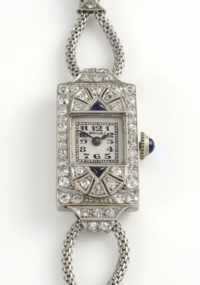 Vintage Swiss ladies platinum, diamond and sapphire wrist watch by Breguet. This wrist watch features a platinum case with diamonds and two trillion sapphires with original silver and enamel dial and double strand stainless steel non kink bracelet, circa 1930-40. 18 jewel movement, case #3442. Restored with one year warranty.