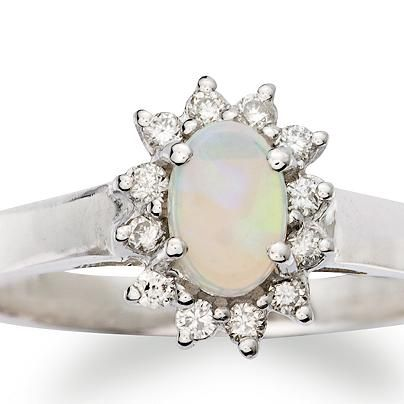 Opal Ring Surrounded By Diamonds In 14kt White Gold