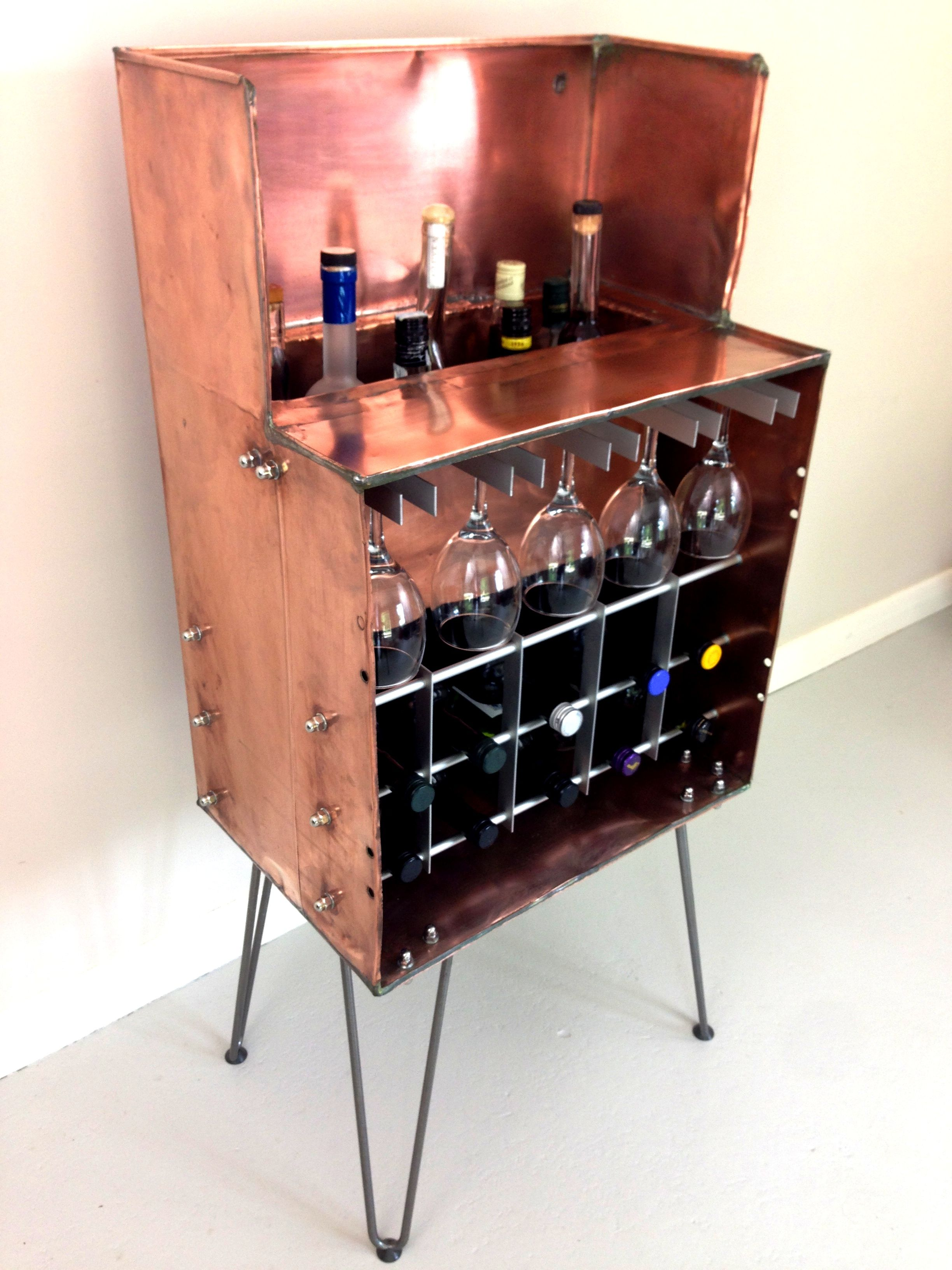 A sneak peek at our latest piece of upcycling! A drinks cabinet made from an old copper water tank! What do you think?!