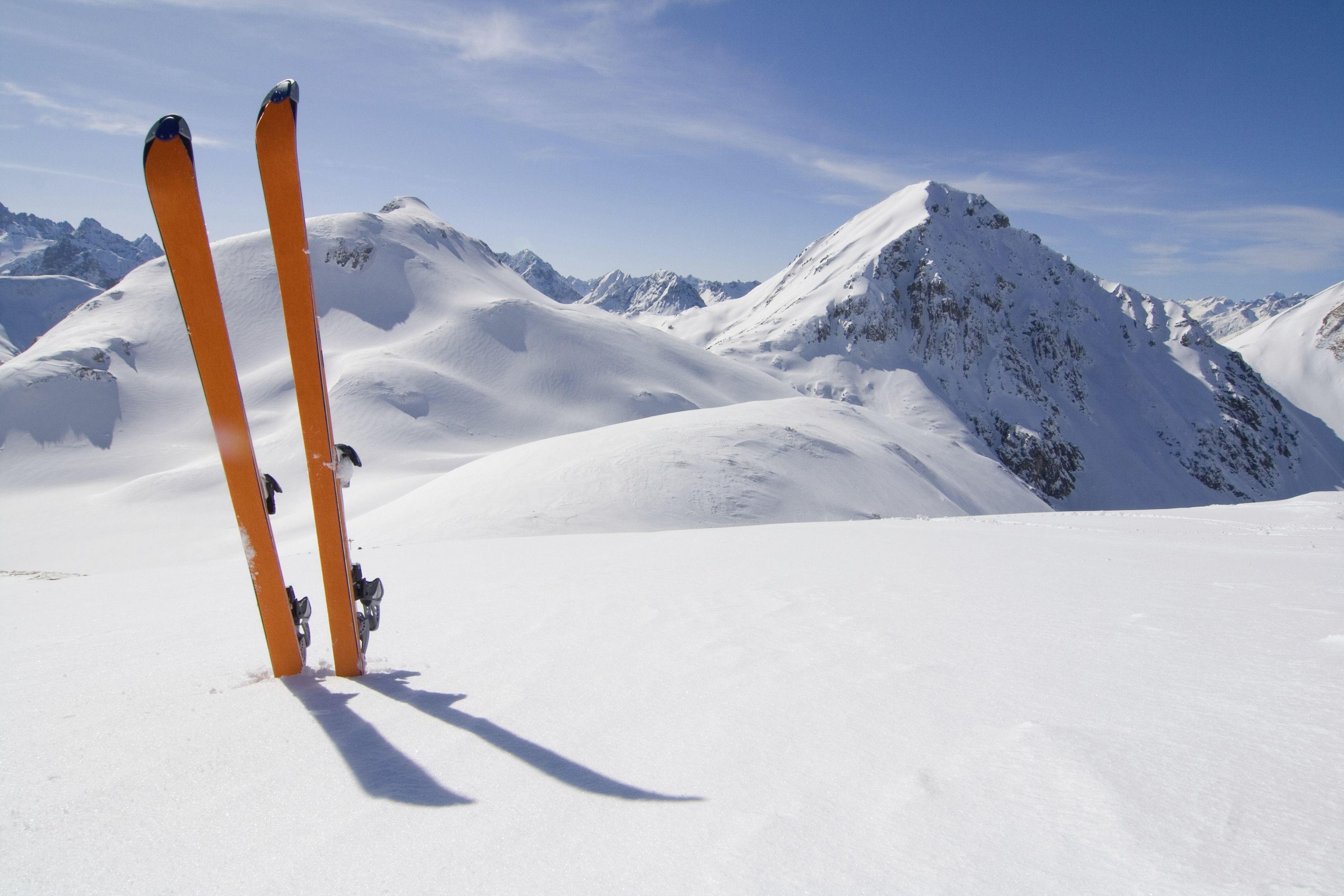 Orange Skis In The Snow
