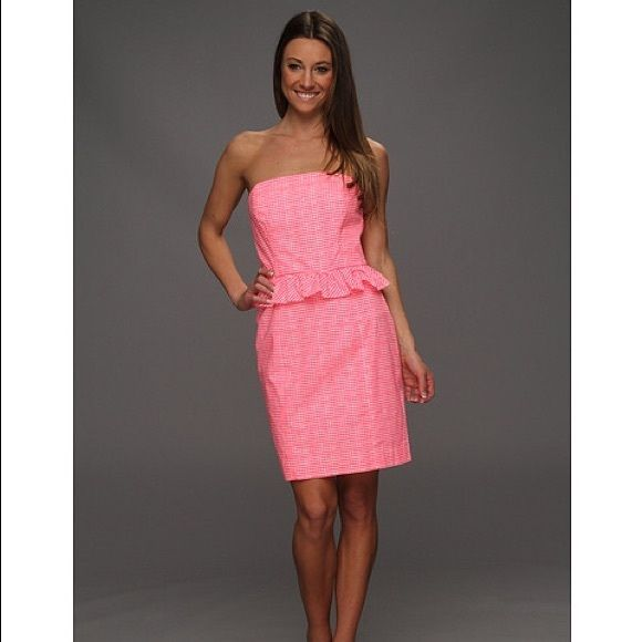 Lilly Pulitzer Lowe Dress Fiesta Pink Gingham NWT size 10 Lilly Pulitzer LOWE DRESS in Fiesta Pink Pretty Gingham. Has a super cute green zipper detail in the back. Peplum and flattering and also neon pink, sooo cute Lilly Pulitzer Dresses Strapless