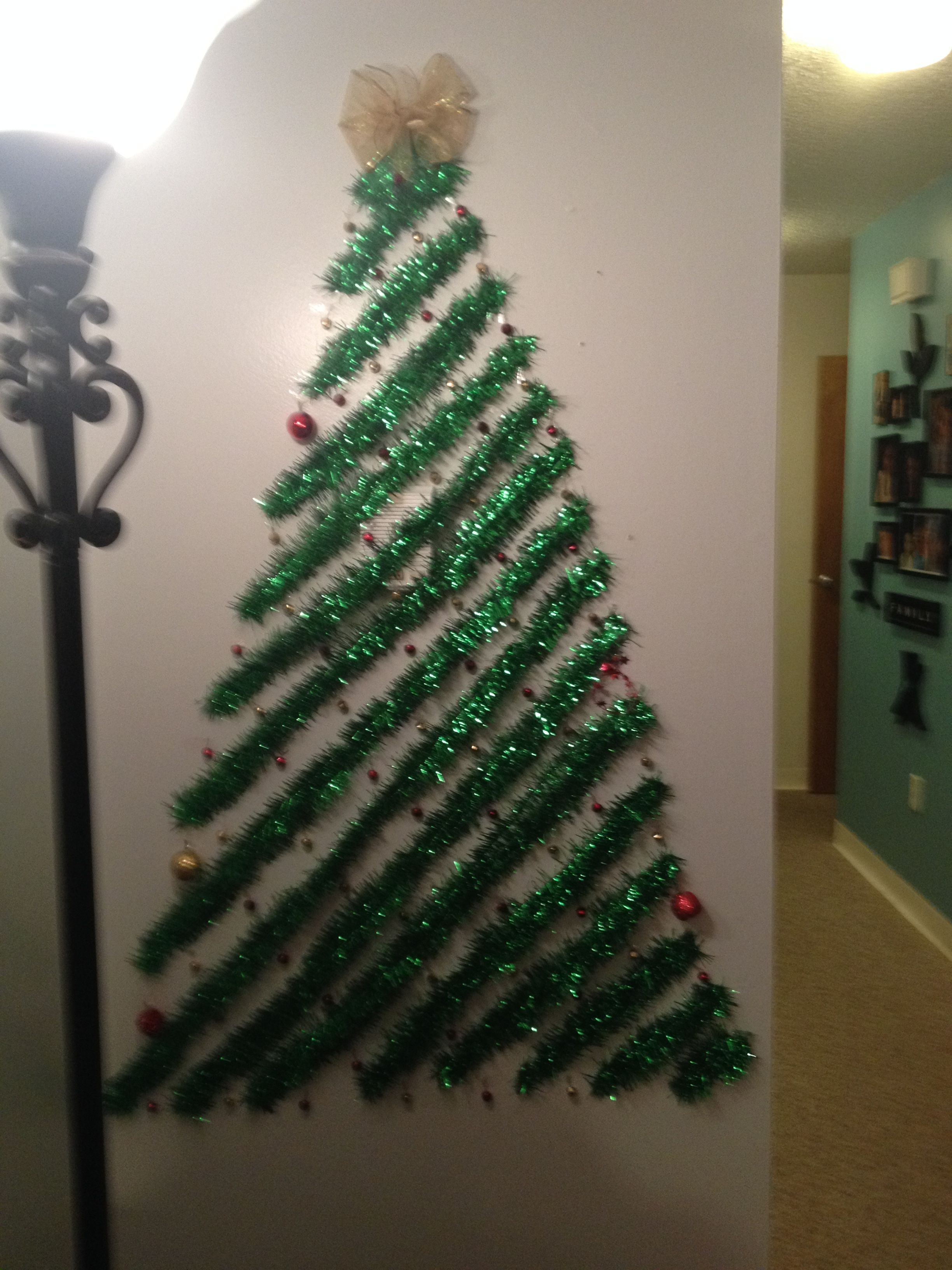 My Christmas Tree This Year When You Don T Have A Christmas Tree Diy Wall Christmas Tree Easy Christmas Decorations Christmas Tinsel