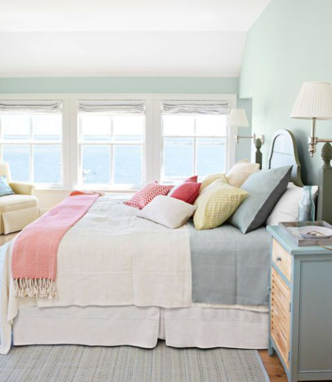 The bed, dressed with a linen Pandora de Balthazar coverlet and shams, and the matching nightstands are by Seabrook Classics.