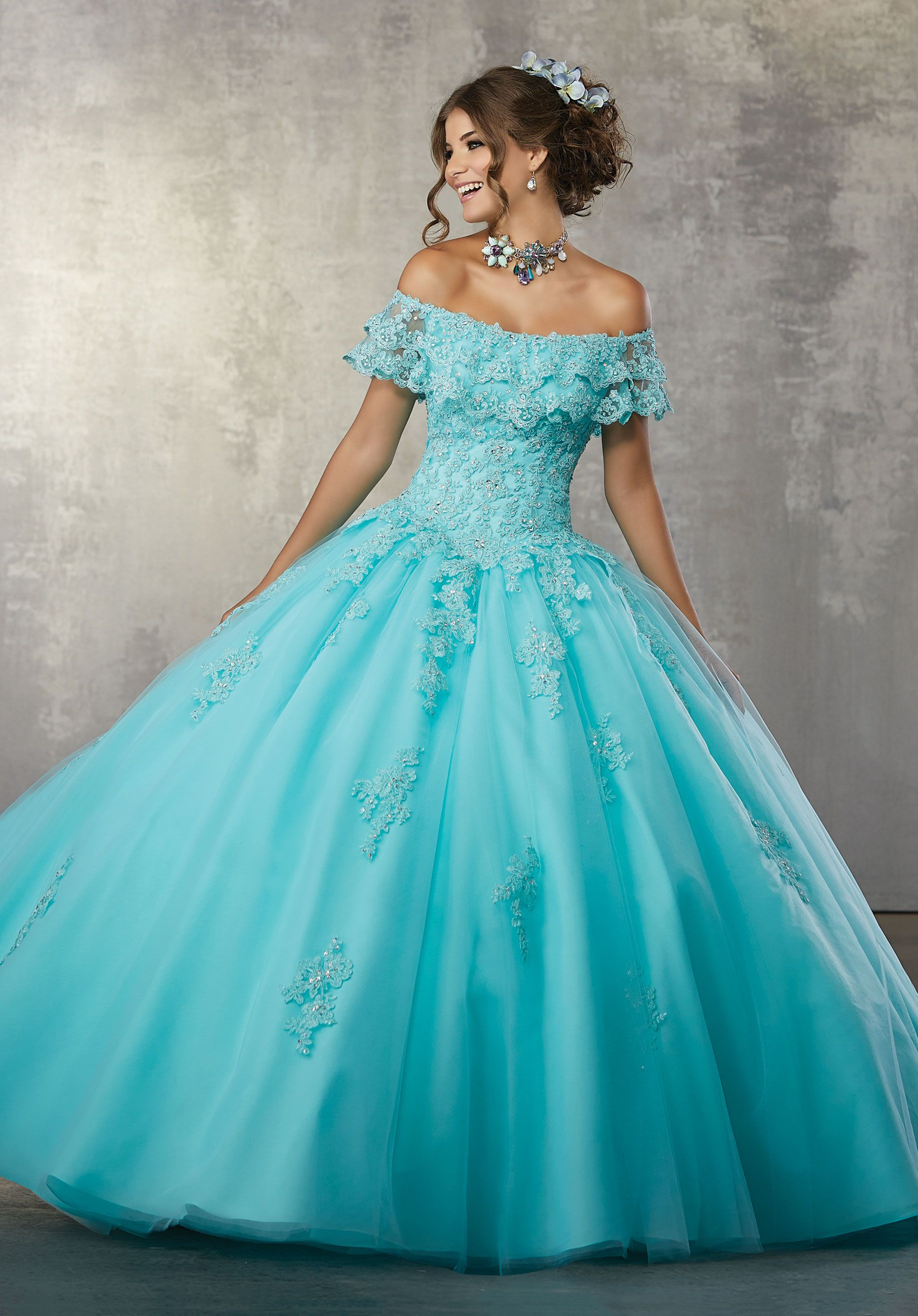 9e4fbe186bd Glamorous Quinceañera Dress Featuring an Off the Shoulder Flounced Neckline  and Full Ballgown Skirt.