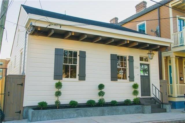 1726 Terpsichore St, New Orleans, LA 70113  gas lamp of front entrance nice concrete planter box for landscaping