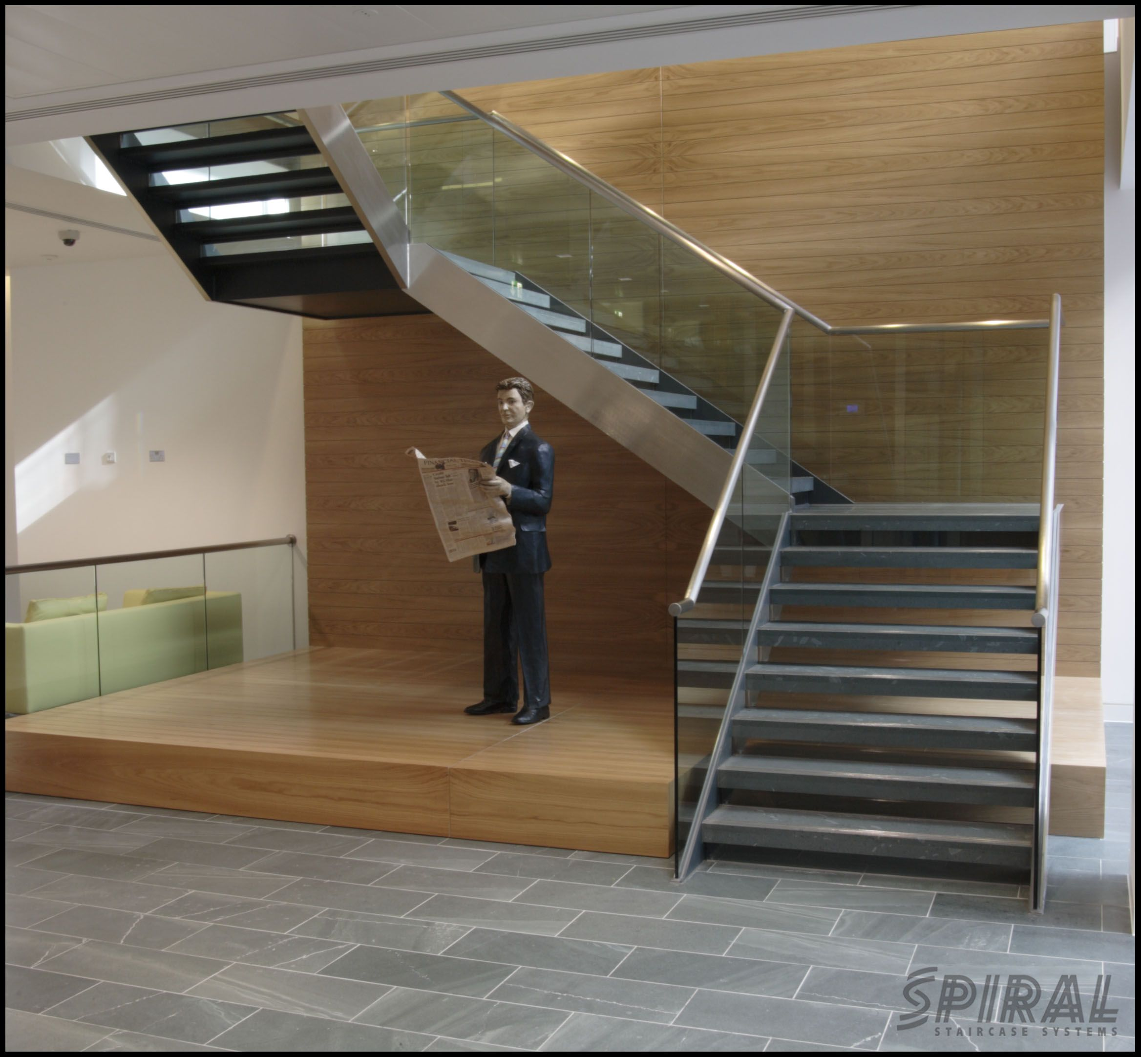 Dog-Leg staircase finished in stone, stainless steel and ...