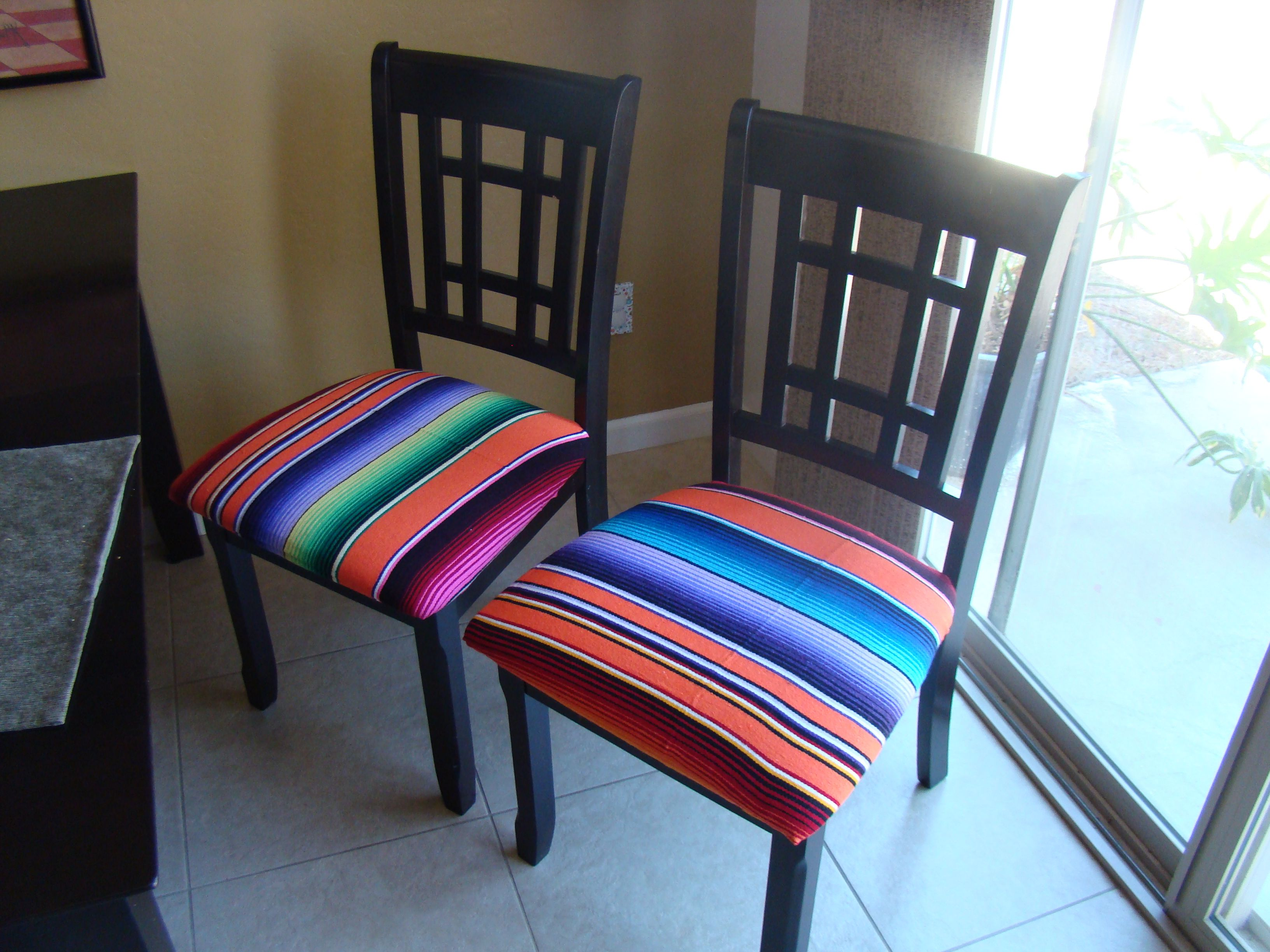 we covered our dining room chairs with mexican serapes it adds a