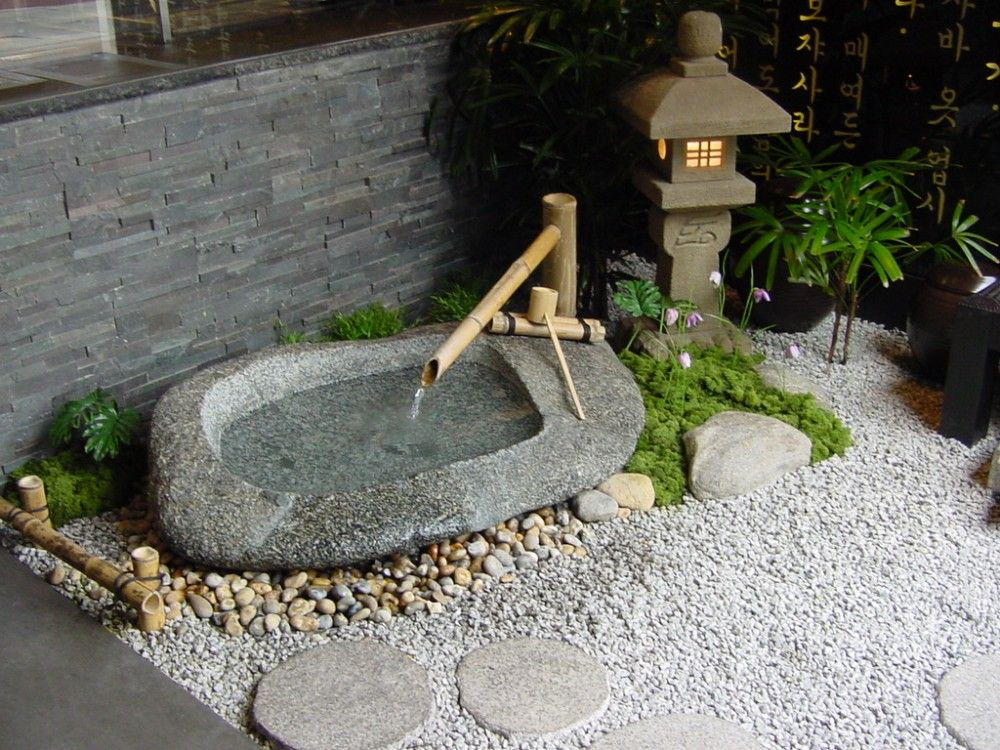 Water basin arrangement in entrance Zen garden design