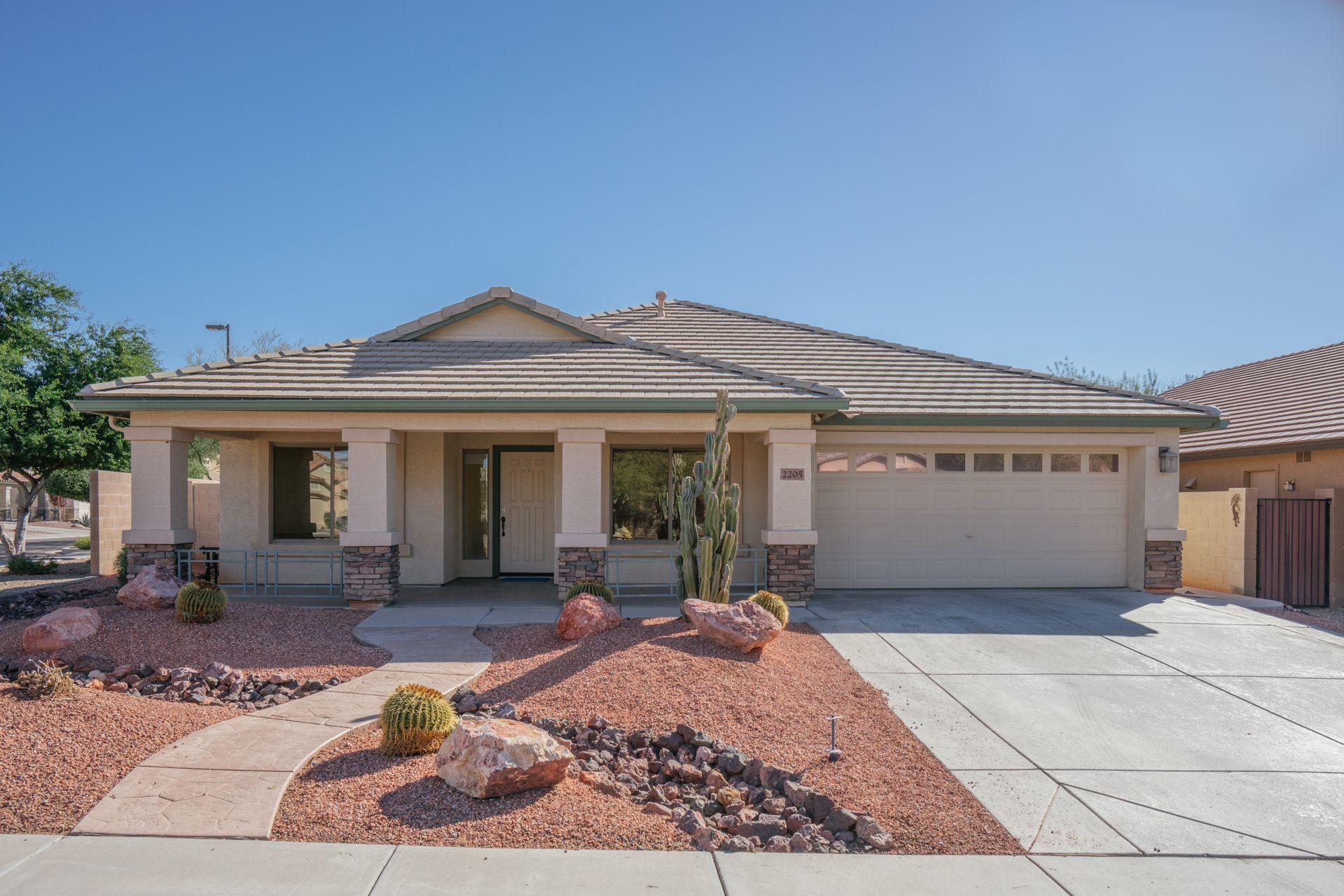 Phoenix, AZ: Brick trim, a spacious front porch with a ...