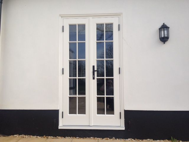 French Door In Bolingbroke Style Featuring Astragal Bars With A Black  Kirkpatrick Handle And Black Hinges