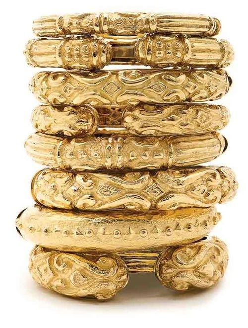 Gold Bracelets Stacked, with a dark tan wearing sunglasses and hat a white bathing suite on a warm sandy beach a cool drink in my hand! So mote it be!