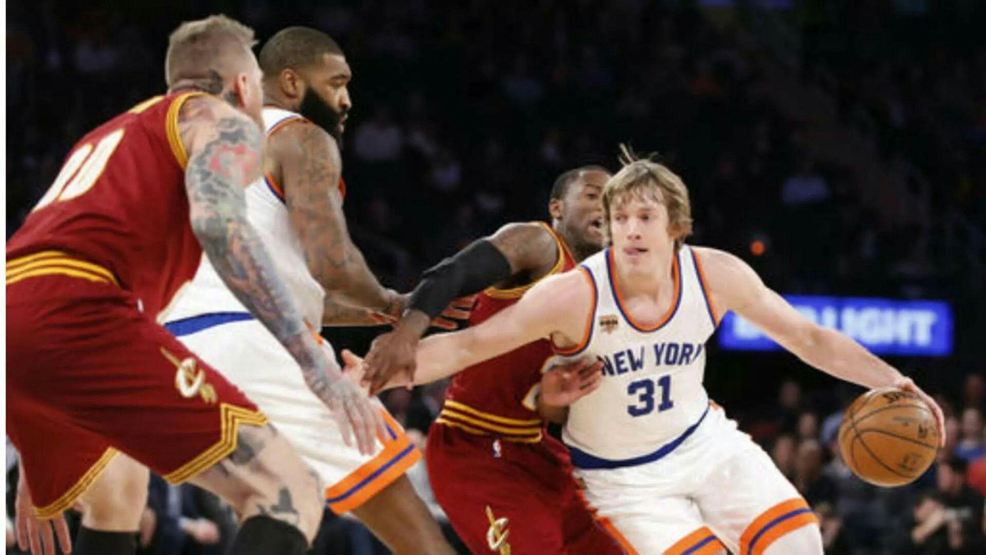 Knicks guard ron baker 31 drives around cleveland