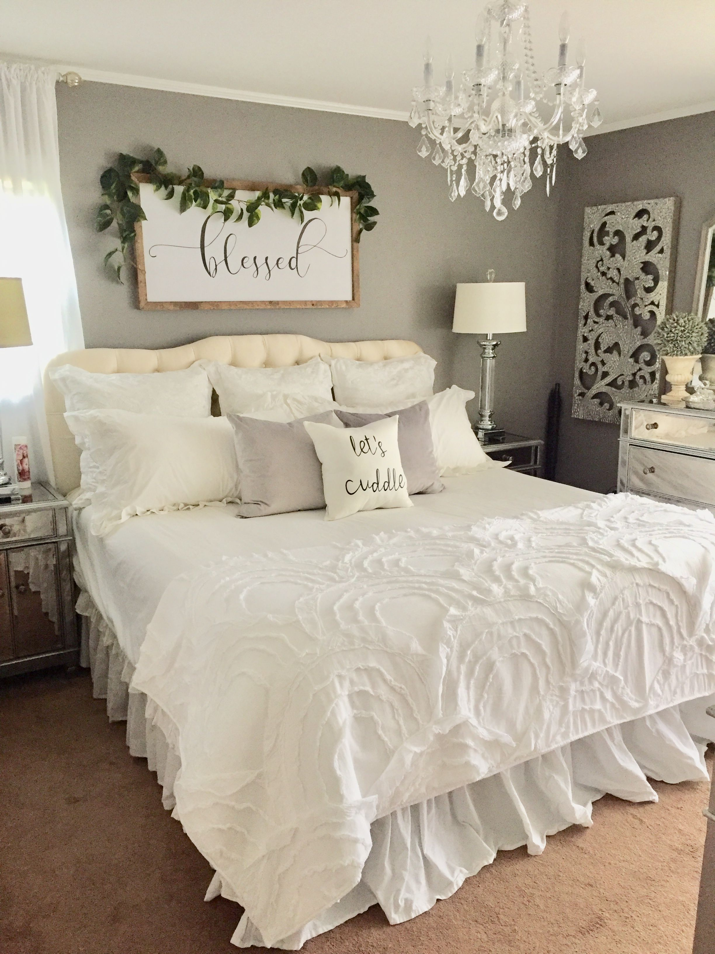 """We decided on forever"" sign with garland above headboard"