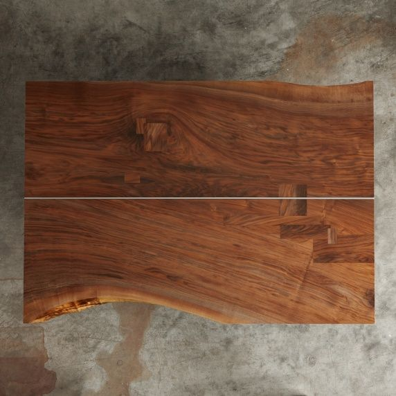 A Walnut Coffee Table With A Satin Nickel Center Spline Live Edges And Walnut Patches We