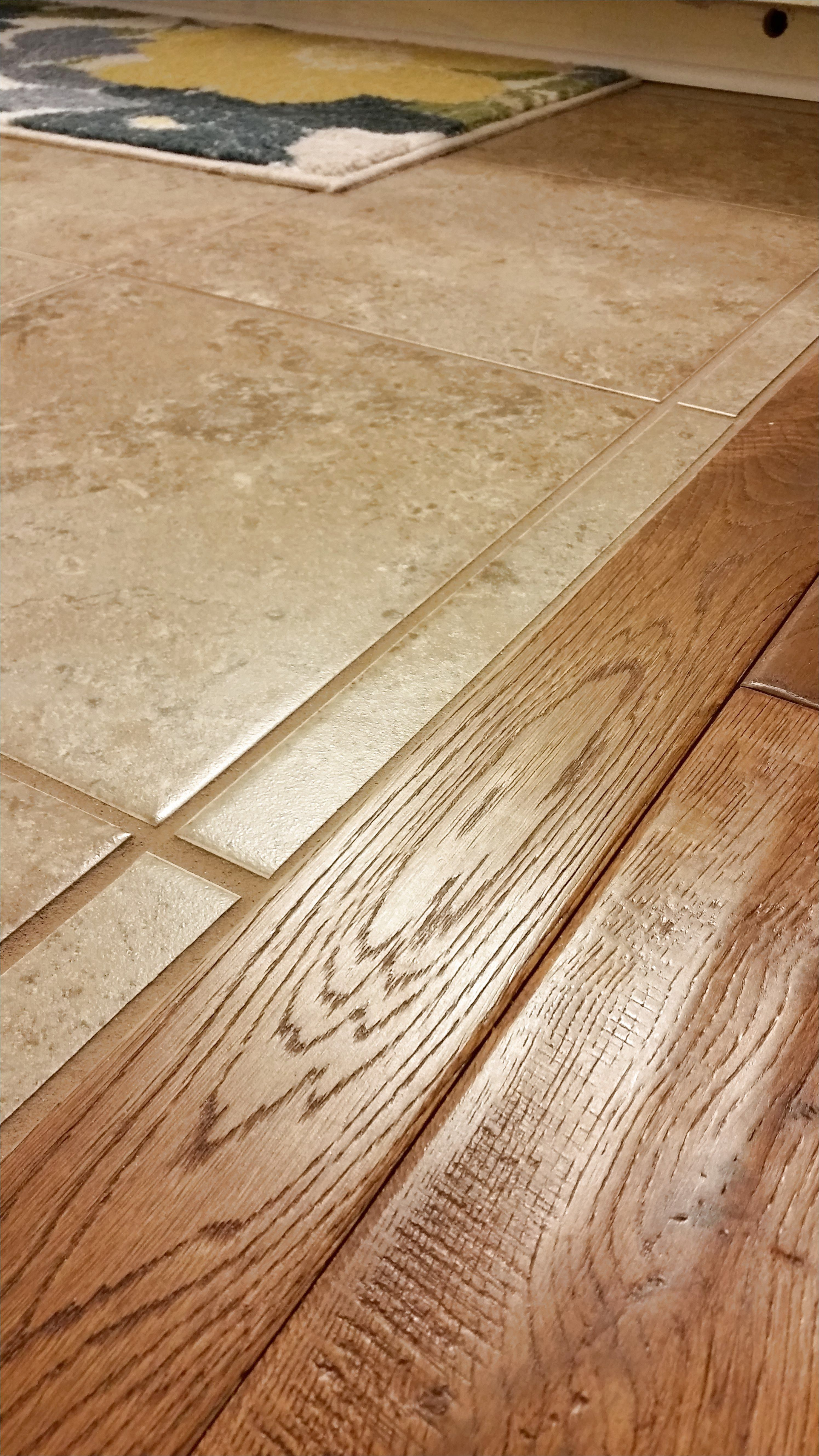 When Wood And Ceramic Tile Meet It Is Sweet Without A Lumpy Transition The Great Indoors Inc Cleveland In 2020 Flooring Wood Tile Floors Tile To Wood Transition