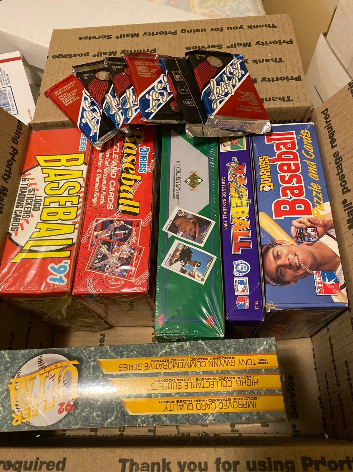Large box of unopened baseball cards including wax and