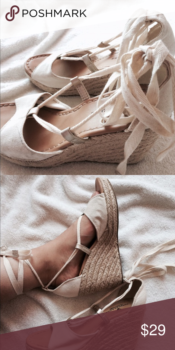 AE Wedges These are cute cream wedges with a high lace. They are perfect for any occasions and are a must in any wardrobe!!💕💕 I've worn these a few times are are in great condition. The bottom of shoes u can definitely tell it's been worn before because it's a little dirty from the ground. But it's not a big problem because they are shoes 😊 American Eagle Outfitters Shoes Wedges