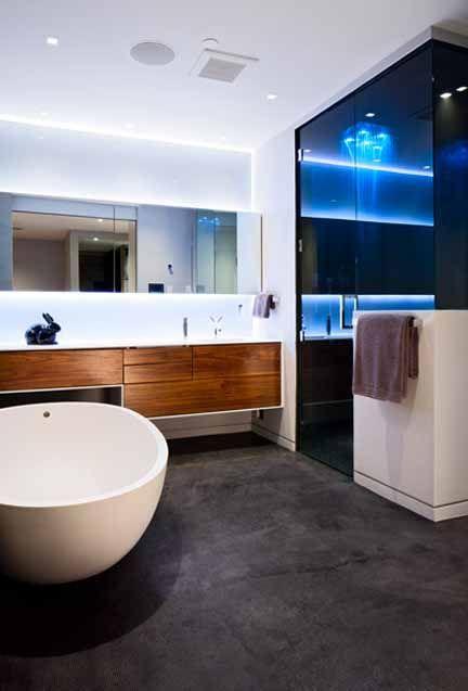 cobalt blue glass steam shower egg tub concrete floor modern home tour vancouver falken reynolds interiors