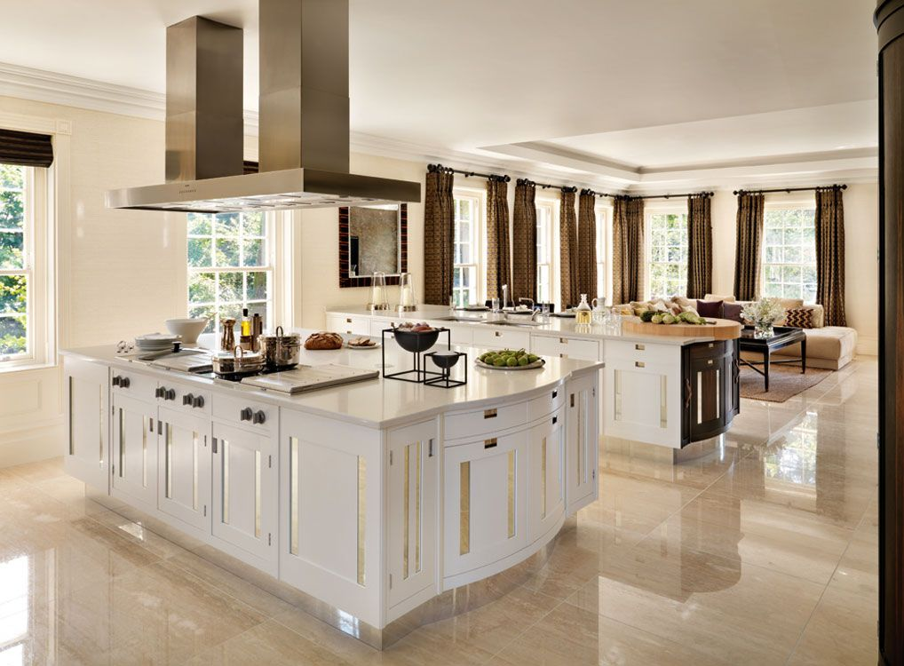 Good example of white kitchen with tan marble floors, but