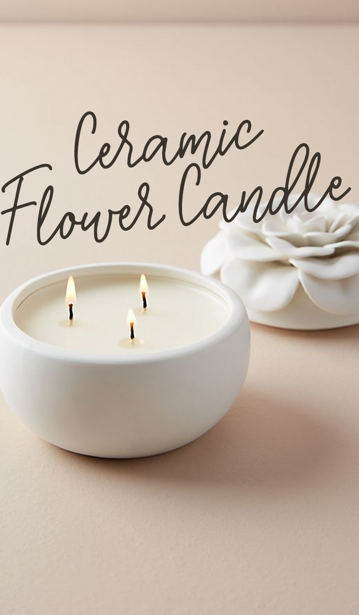 Housed in a beautiful ceramic vessel, this scented candle imparts a ...