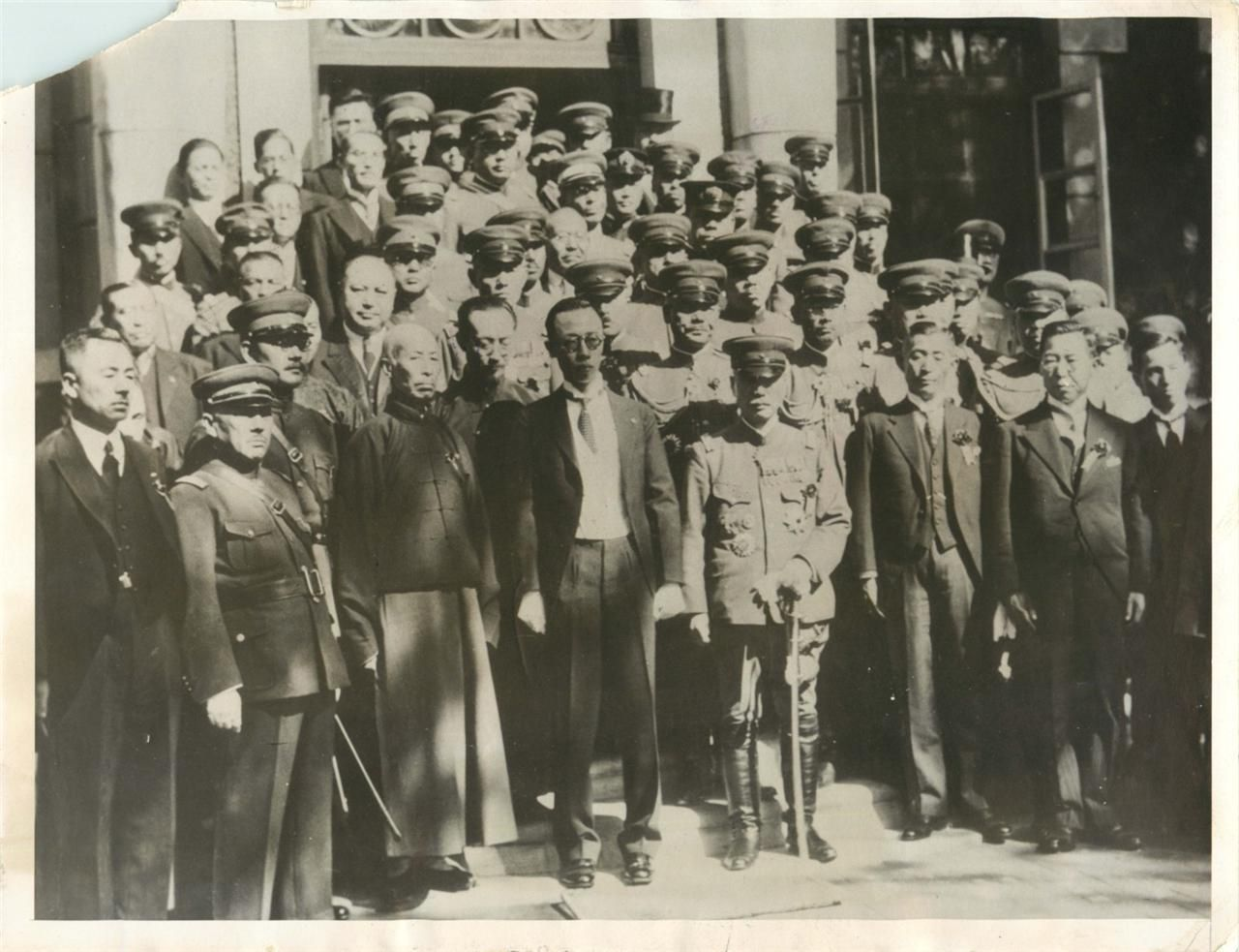 1932- Japanese and Manchurian delegates just after the coronation ceremony  of Henry Pu-Yi in Hsinching. Premier Cheng Hsiao-Hsu is on Pu-Yi's left and  ...