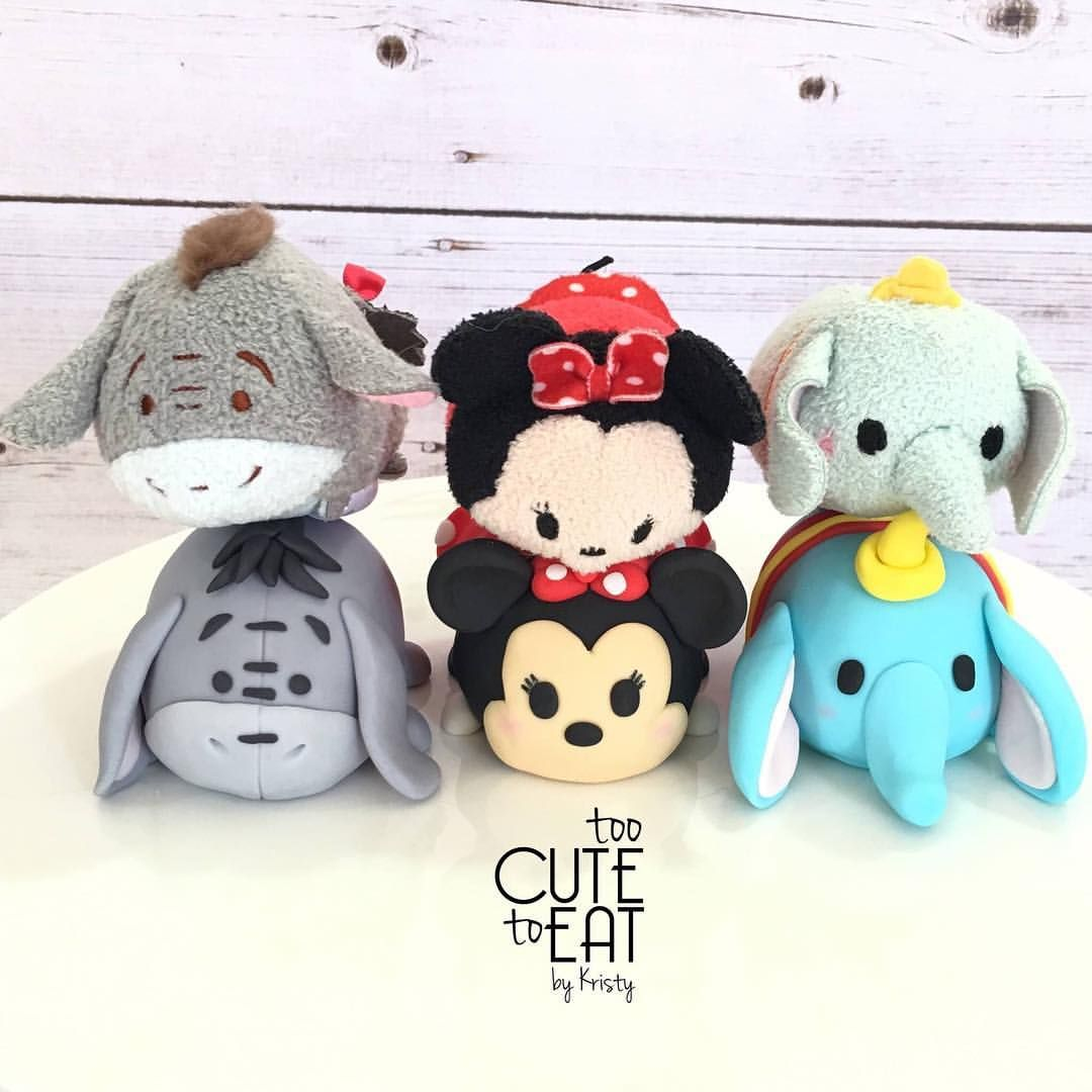 Tsum Tsum Rice Krispy Treats covered in fondant cake toppers with their tsum tsum soft toys models - Eeyore, Minnie Mouse, Dumbo