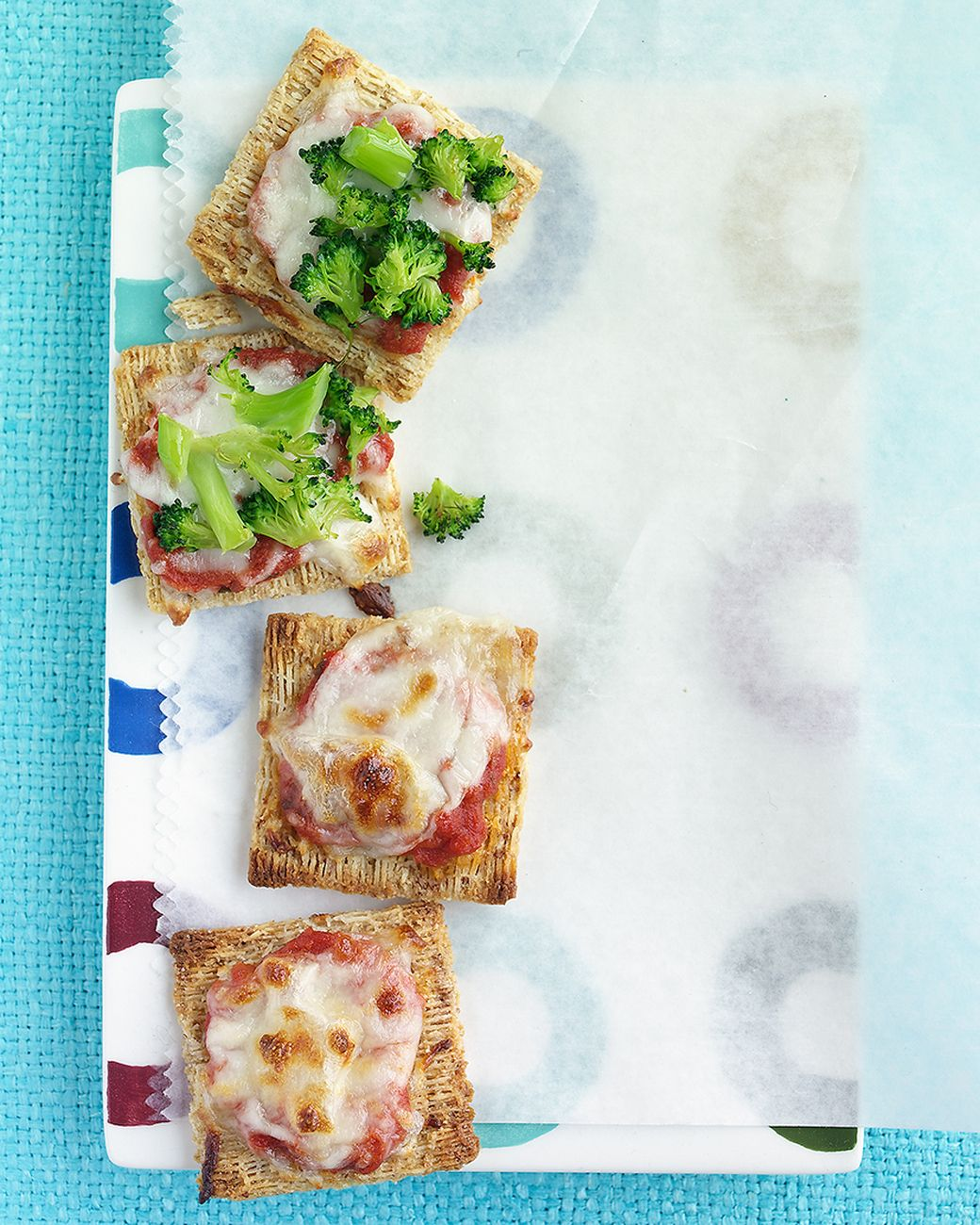 Pizza Crackers | Martha Stewart Living - You can use any of your favorite pizza toppings on these crackers. Try diced deli ham, chopped bell pepper, or pineapple chunks.