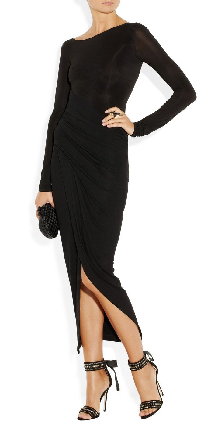Donna Karan's Black Jersey Dress focuses on fit and form. Effortlessly draped across the torso, this body-skimming Design transforms both slight and curvier frames into an hourglass shape. Accent with Gold Jewelry.
