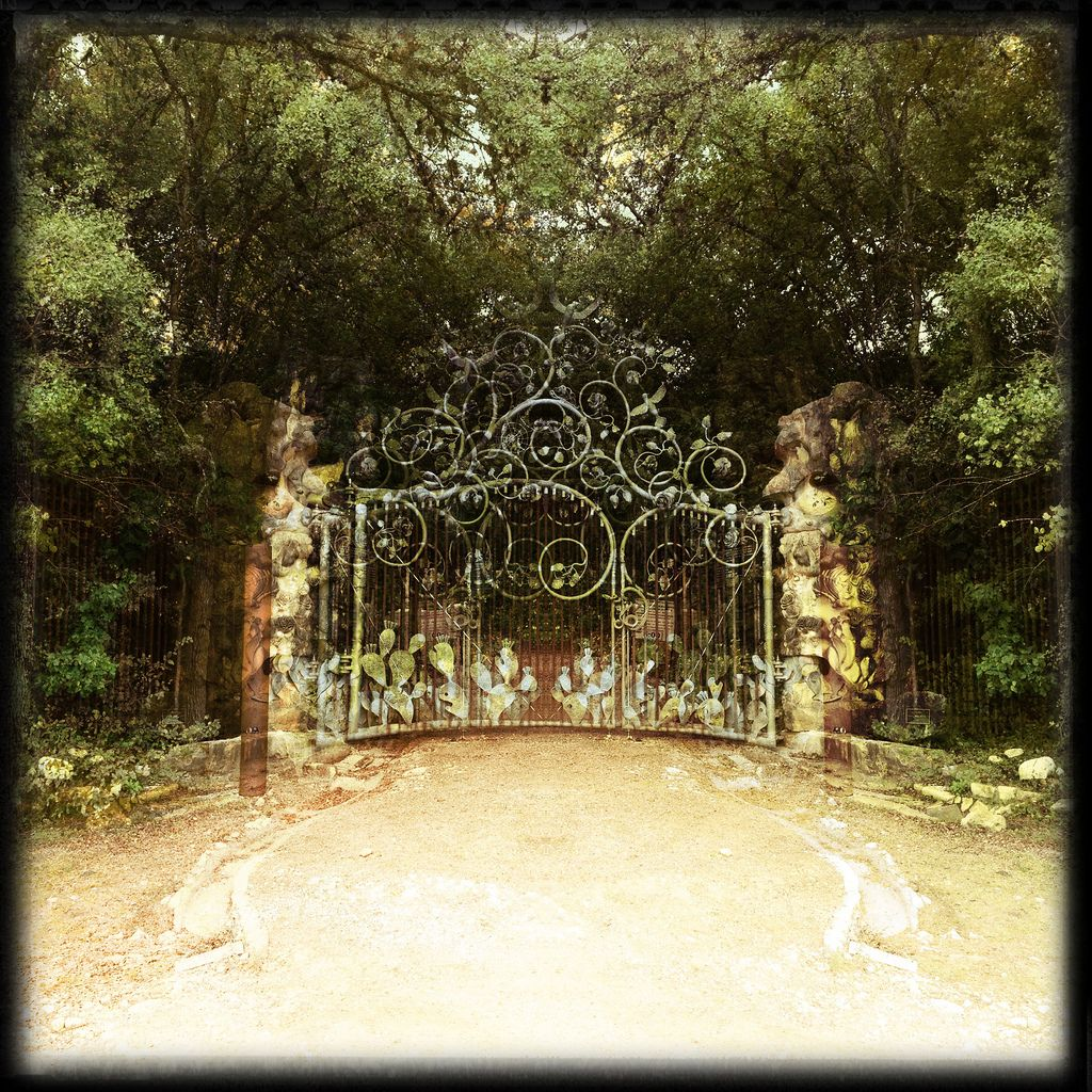 Double exposure of the rear gate at Zilker Botanical Garden ...