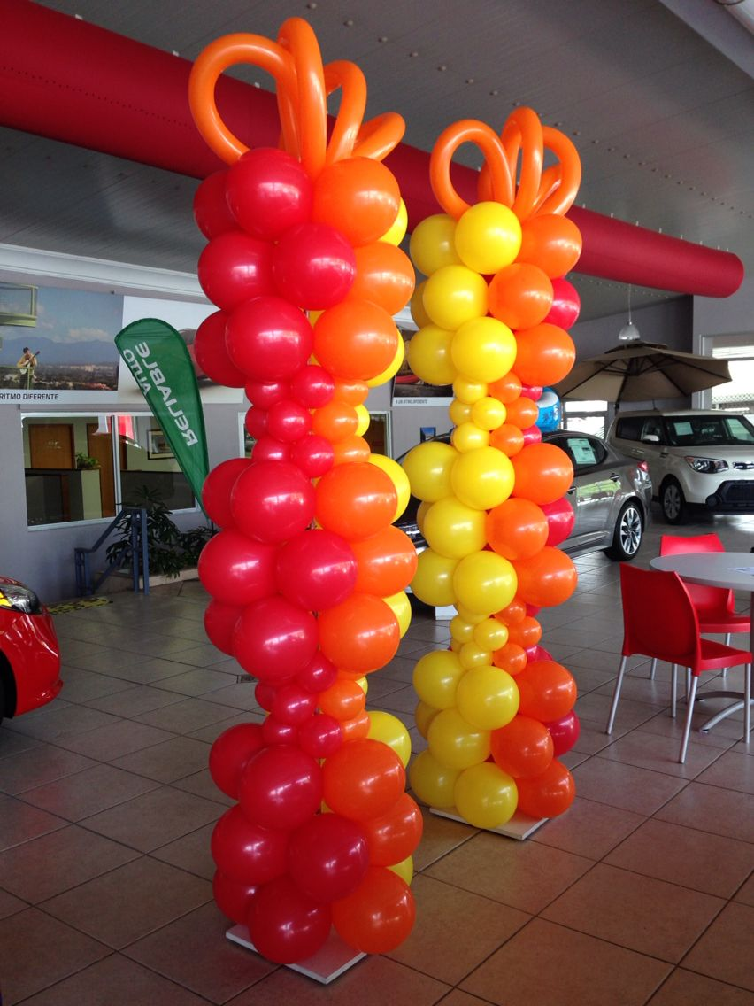 Red orange and yellow tall balloon columns great for car for Balloon column decoration